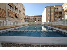 Квартира с 2 спальнями в центре Торревьехи в доме с бассейном