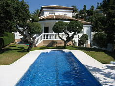 Charming villa with swimming pool, mature gardens and open views