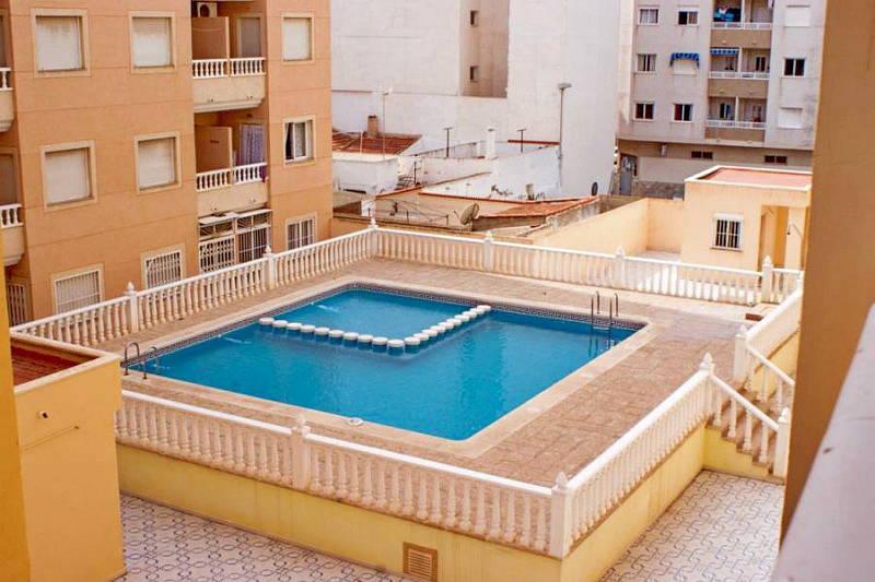 Квартира в торревьехе с бассейном