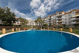 Lovely ground floor apartment with private terrace and garden area in Los Pinos de Nagueles a gated community with 24 hour security, Marbella