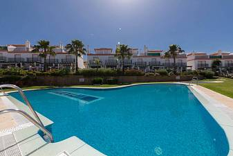 Attractive 2 bedroom townhouse with extensive private terrace and garden space and partial sea views Las Lomas de Cabopino, Marbella