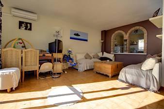 Spacious three bedroom duplex top floor apartment situated within the Pueblo of Benahavis