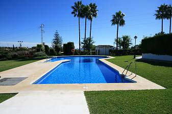 Cosy townhouse in a lovely well maintained community within walking distance of local shops, restaurants and even the beach at Costalita Bel-Air