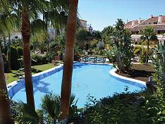 Elegant duplex penthouse has a spacious light-filled living and dining area with a stylish fireplace in very quiet area of Nueva Andalucia, Marbella