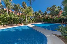 Superb luxury townhouse with private south facing garden in the exclusive gated community of Monte Marbella, Altos de Puente Romano, Marbella