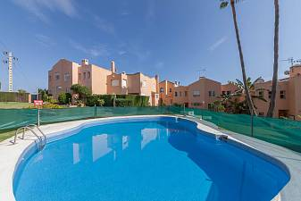 Spacious character family townhouse in a gated community with communal gardens and pools just 10 - 15 minutes drive from Marbella, Puerto Banus