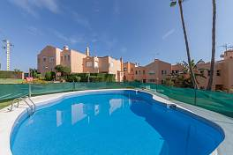 Spacious family townhouse in a gated community with communal gardens and pools within easy walking distance of local amenities, Estepona