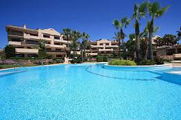 Beach front 2nd floor apartment on the southwest corner of this prestigious community located between Estepona and Marbella