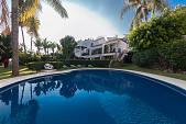 Semi detached villa / townhouse in the prestigious Marbella Hill Club overlooking the Marbella coastline and just a short drive from all facilities
